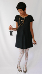 Custom designed Uniform necklace made and donated by Suzy Nelson  Visit her Etsy store at  a href  http   www etsy com shop php user_id 6424518  target  _blank  TwoToeDesign Etsy com   a     Tights from  a href    http   www celestestein com   target  _blank  Celeste Stein  a     and vintage pumps from eBay