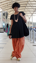 At the Bombay airport in a dhoti raided from my lovely hostess Miriam s wardrobe  vintage gold pumps donated by Jessica Carroll  bangles from the Dumbo flea market and a hand knotted rope necklace donated by Michelle Lane  See more of Michelle s creations at  a href  http   www michellelane net  target  _blank  michellelane net     a    br  br On route back to New York after a fabulous and fulfilling trip  despite all the ailments and such  See you all on the flip side