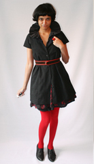 Iwona Ludgya collared tunic paired with a printed mini skirt  vintage belt and Bakelite ring 